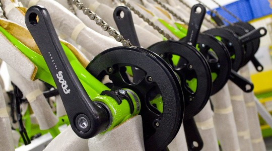Bespoke crank arms being fitted to a Frog Kids Bike in the factory
