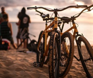 Kona Hybrid Bikes on the beach