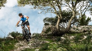 Suunto mountain biker on a technical path